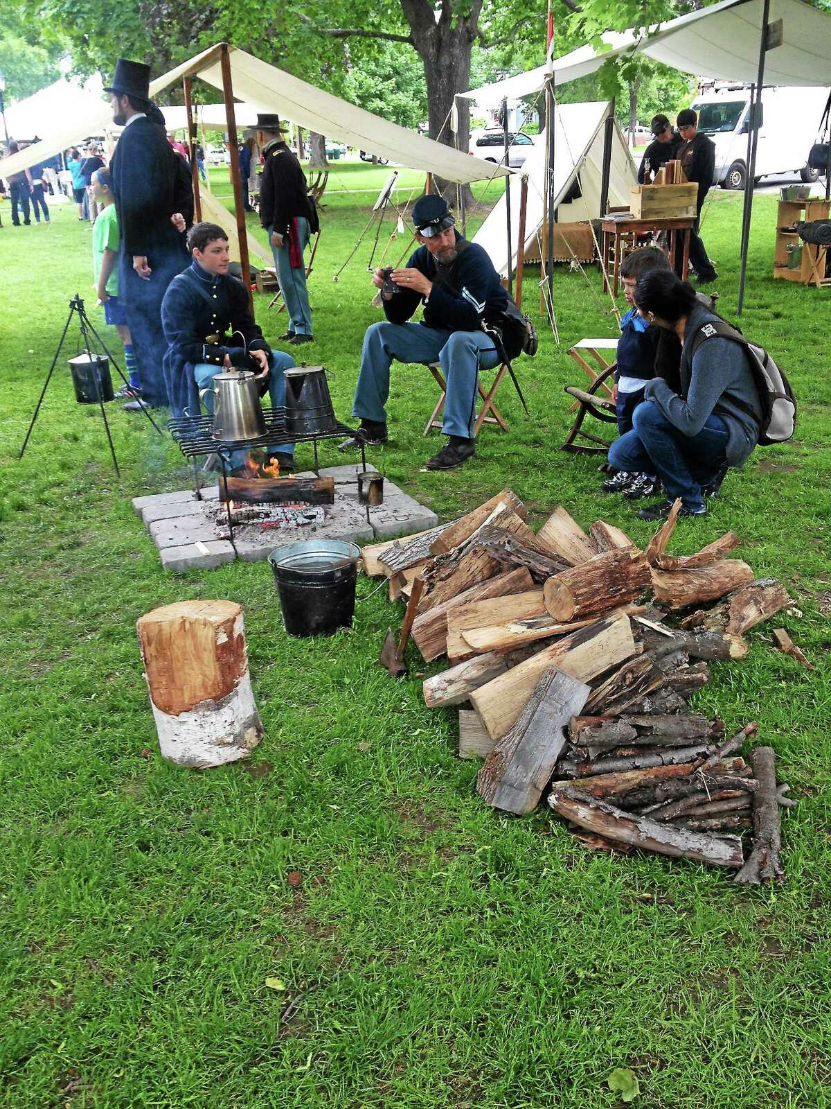 Re-enactors tend to a fire at
