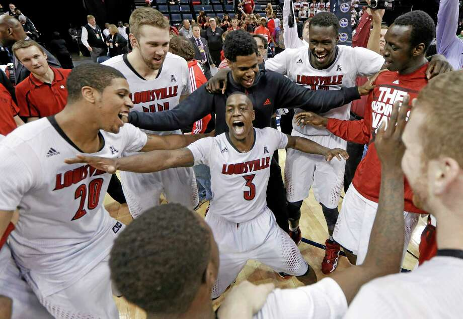 Louisville celebrates after beating UConn 71-61 in the championship game of the American Athletic Conference tournament on Saturday in Memphis, Tenn. Photo: Mark Humphrey — The Associated Press  / AP