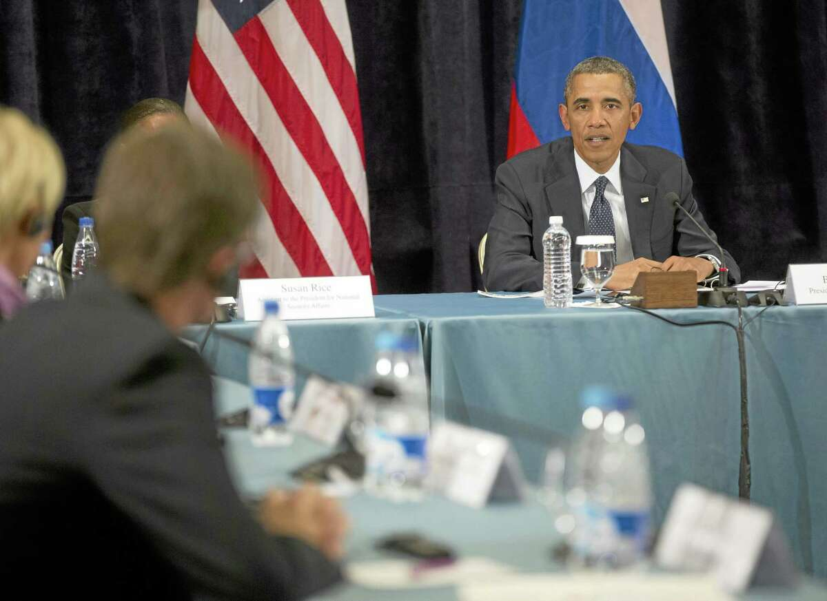 """President Barack Obama participates in a """"Civil Society Roundtable,"""" Friday, Sept. 6,2013, in St. Petersburg, Russia. At left is Igor Kochetkov chairman of the Russian LGBT Network."""