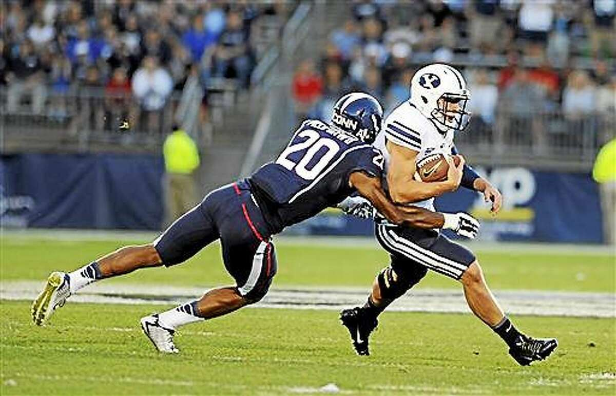 The Associated Press / Jessica Hill Connecticut safety Obi Melifonwu (20) is day-to-day with an upper-body injury.