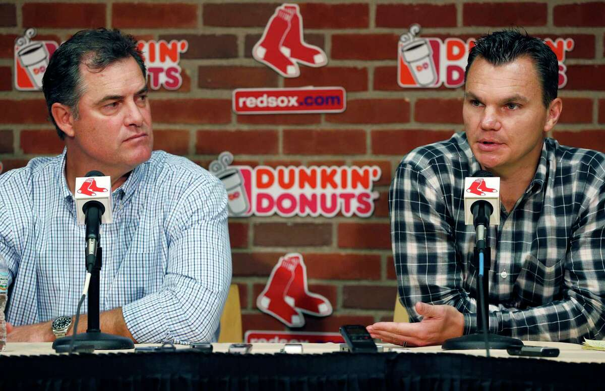 Red Sox manager John Farrell, left, and general manager Ben Cherington speak with reporters during a news conference at Fenway Park on Monday.