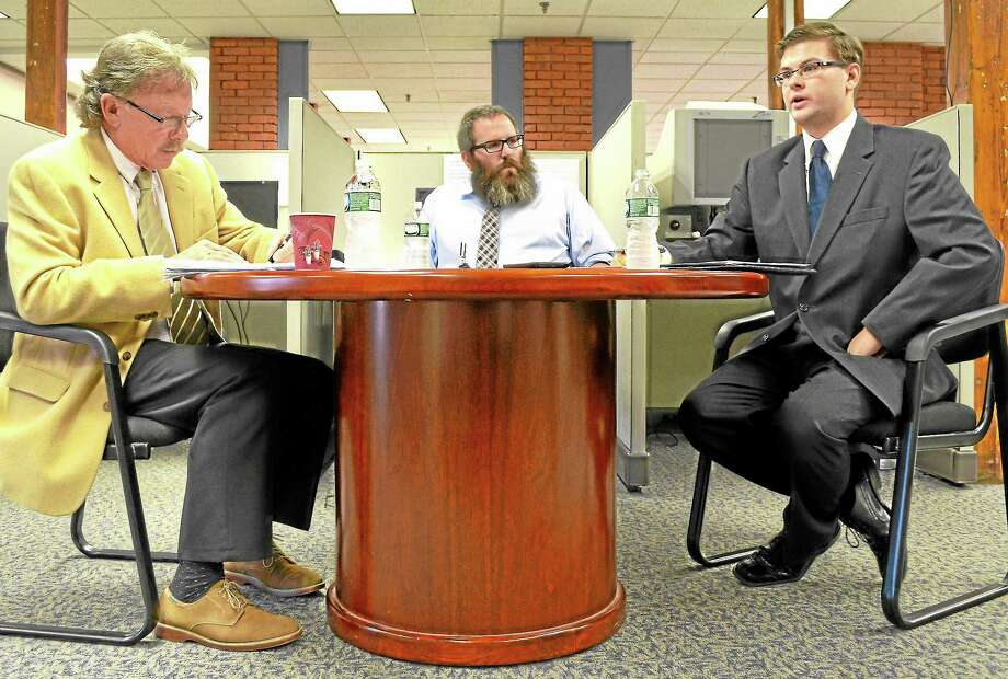 Torrington mayoral candidates George Craig, left, and Collin Good, right answer questions posed by Register Citizen Editor John Berry, center, during the Democratic primary debate at the Register Citizen Newsroom Cafe on Field St. in Torrington. Photo: Esteban L. Hernandez—Register Citizen