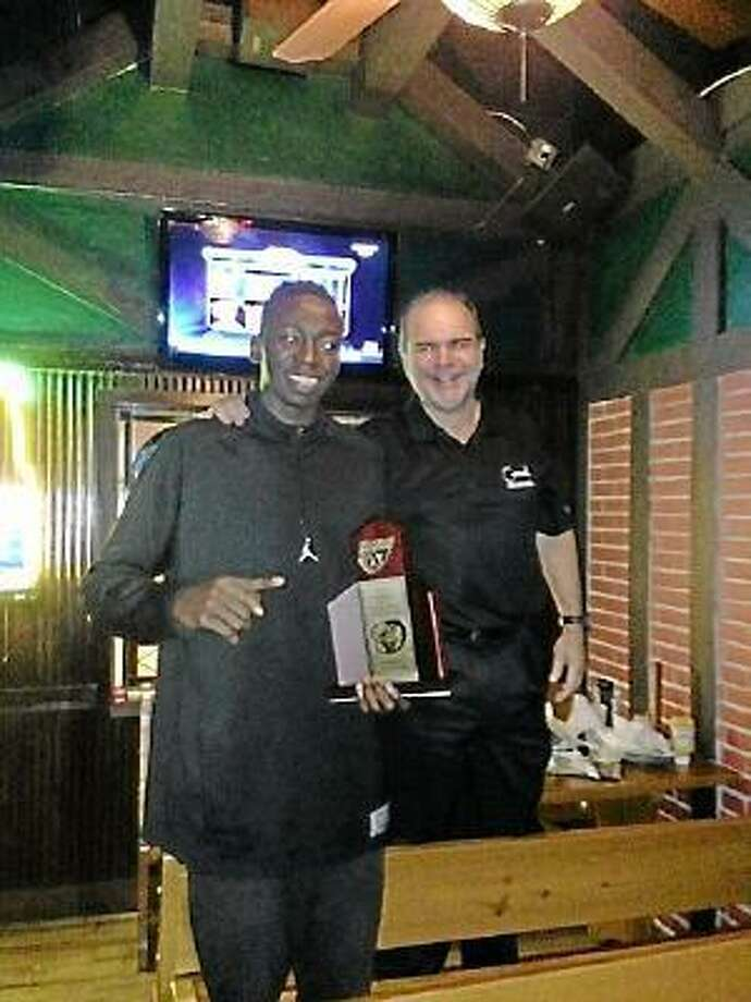 UConn recruit Amida Brimah stands with his Archbishop Carroll High School head coach Juan Hernandez. Submitted Photo