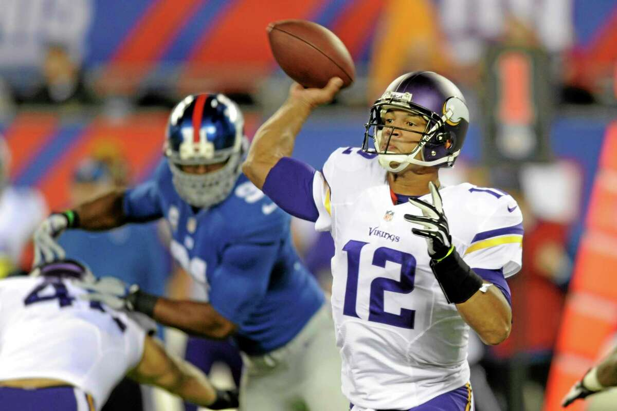 In this Oct. 21, 2013 file photo, Minnesota Vikings quarterback Josh Freeman throws a pass during a game against the New York Giants in East Rutherford, New Jersey.