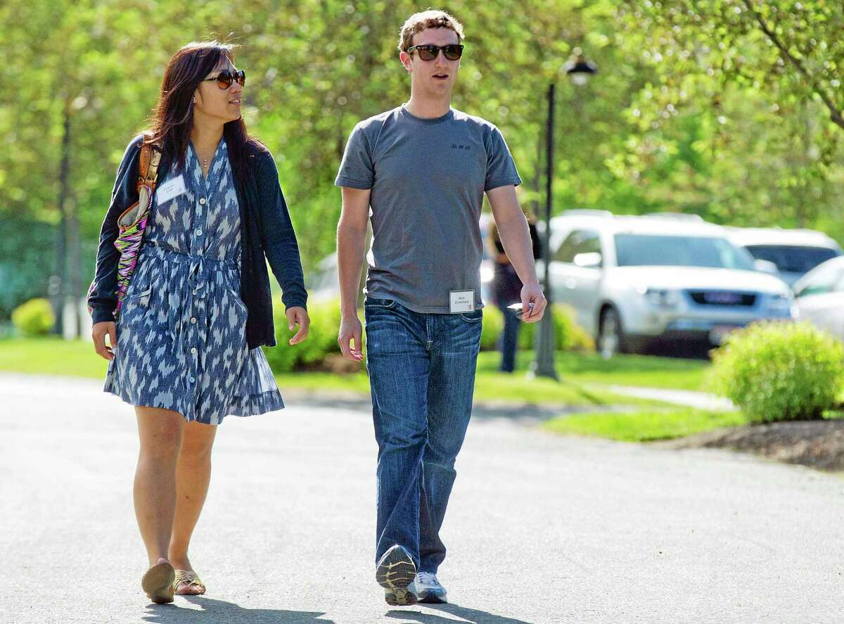 FILE- In this July 9, 2011, file photo, Mark Zuckerberg, president and CEO of Facebook, walks to morning sessions with his then girlfriend Priscilla Chan during the 2011 Allen and Co. Sun Valley Conference, in Sun Valley, Idaho. Zuckerberg and his wife, Priscilla Chan, announced Thursday May 29, 2014 they are donating $120 million to the San Francisco Bay Area's public school system. Zuckerberg and Chan, a pediatrician, discussed the donation in an exclusive interview with the Associated Press. (AP Photo/Julie Jacobson)