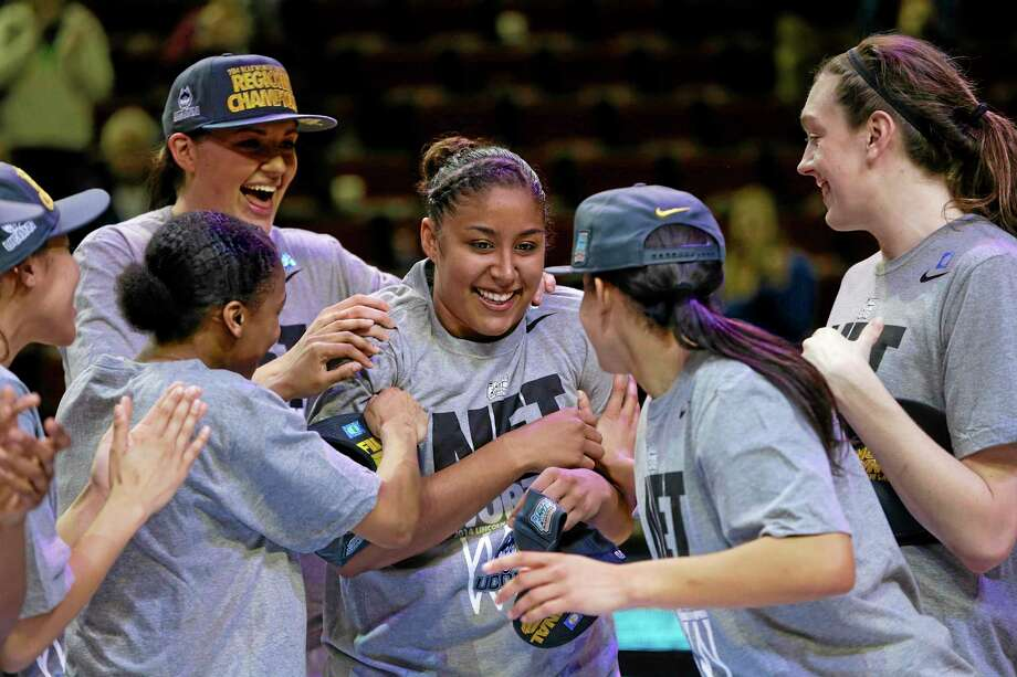 UConn players including Stefanie Dolson, top left, and Breanna Stewart, right, celebrate with Kaleena Mosqueda-Lewis, center, after beating Texas A&M, 69-54 in the Lincoln regional final on Monday. Photo: Nati Harnik — The Associated Press  / AP
