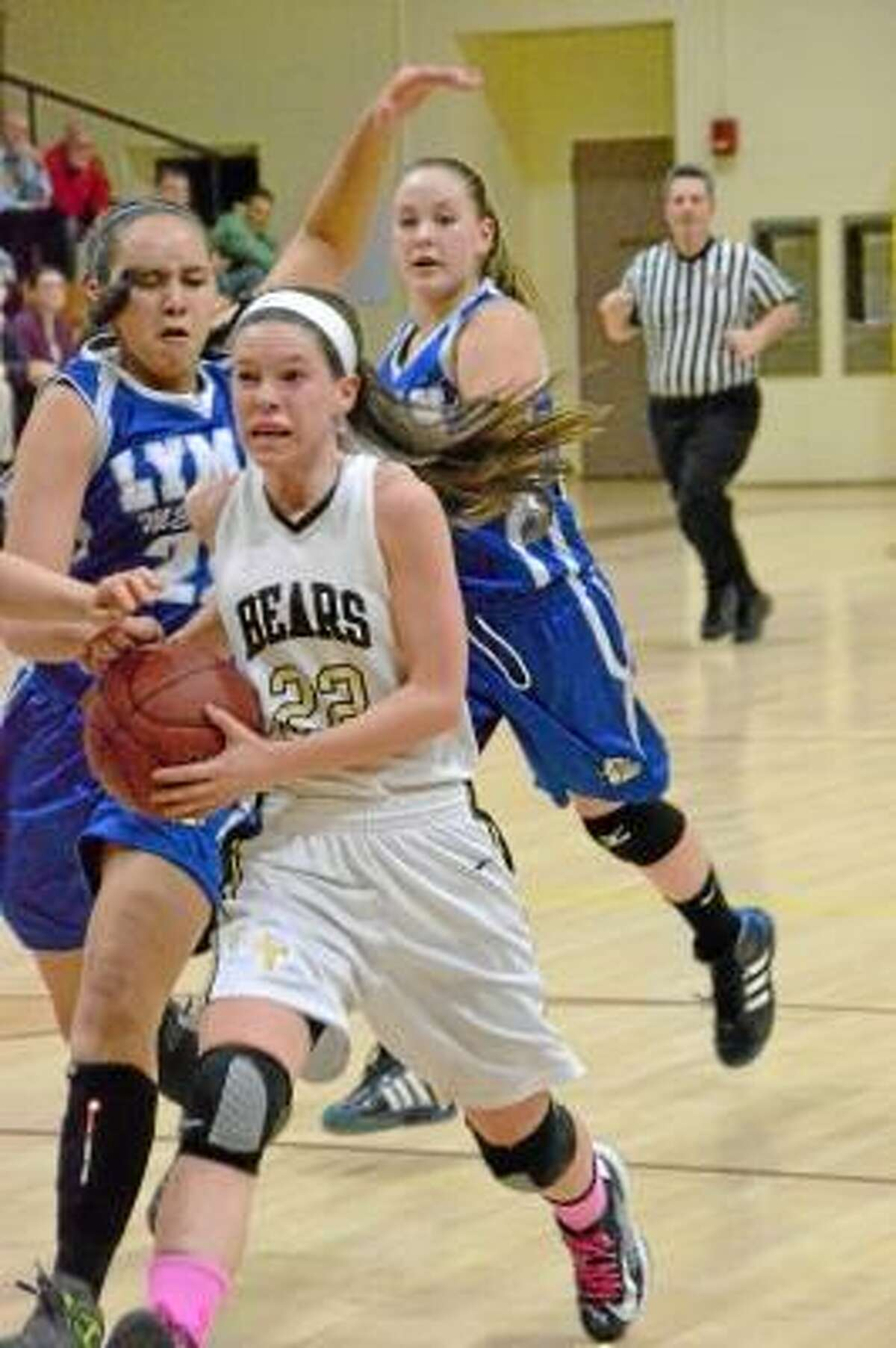 Thomaston's Maggie Eberhardt drives to the basket in the Golden Bears' 64-41 victory against Lyman Memorial. Photo by Pete Paguaga/Register Citizen