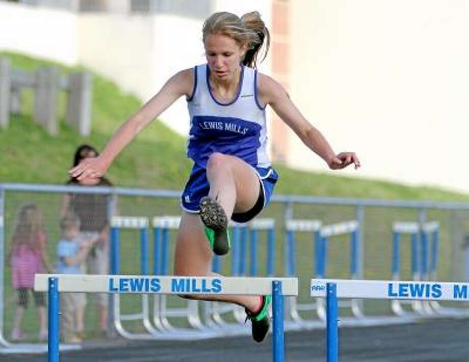 Photo by Marianne Killackey/Special to Register Citizen Lewis Mills' Ailene Berry competes in the 300 meter hurdles. Berry placed first in the event with a time of :49.8. / 2013