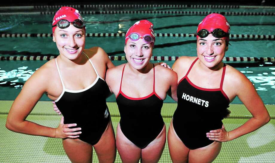 Arnold Gold — The Register Left to right, Branford swim captains Lauren Rasile, Paige Cacace and Christina Smith. Photo: Journal Register Co.