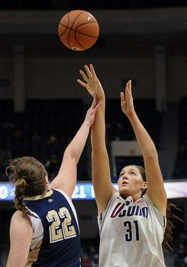 Connecticut's Stefanie Dolson shoots over Pittsburgh's Krista Pettepier during the second half of an NCAA college basketball game in Hartford, Conn., Tuesday, Feb. 26, 2013. Connecticut won 76-36. (AP Photo/Jessica Hill) Photo: ASSOCIATED PRESS / A2013