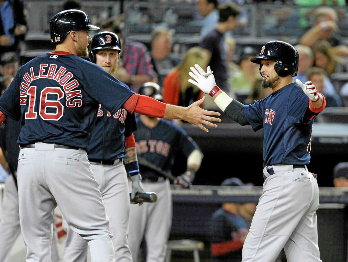 Boston Red Sox batter Shane Victorino, right, celebrates with Will Middlebrooks after Victorino hit a two-run home run during the eighth inning of a baseball game against the New York Yankees Friday,