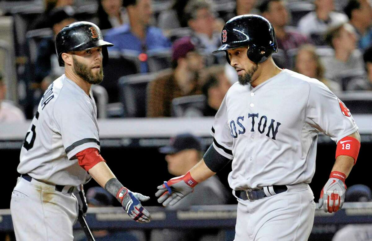 Shane Victorino, right, celebrates with teammate Dustin Pedroia after scoring in the fifth inning Thursday.