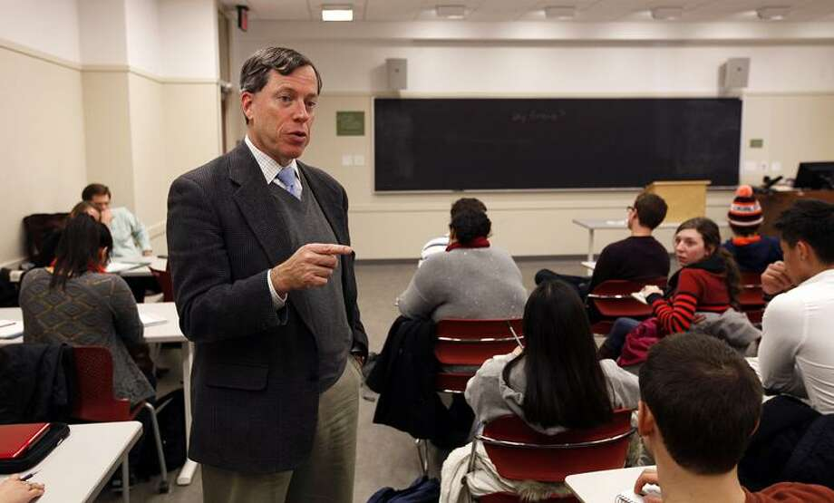 Philip Zelikow leads a discussion in a modern history course he is teaching at the University of Virginia. Zelikow, who is liberated from the obligation to lecture in class because his talks are now viewable online, leads discussion sections himself every Tuesday. (Photo for The Washington Post by Norm Shafer.) Photo: THE WASHINGTON POST / THE WASHINGTON POST
