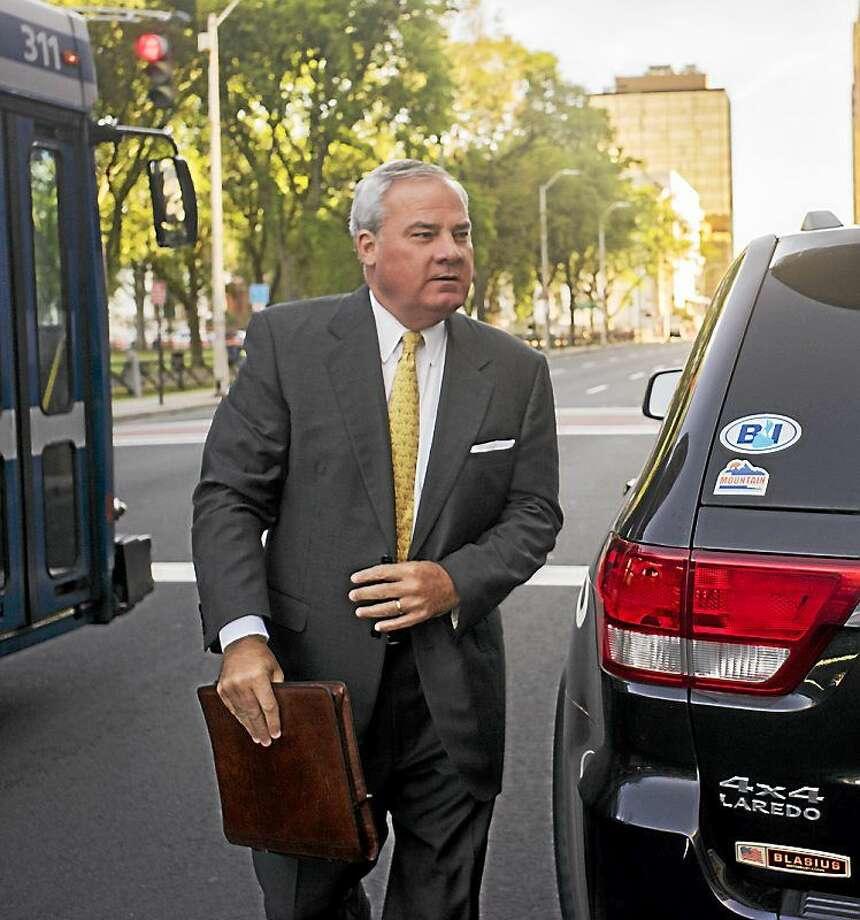 Douglas Healey - CTNewsJunkie.com Former Gov. John G. Rowland arrives Thursday at U.S. District Court in New Haven. Photo: Journal Register Co.