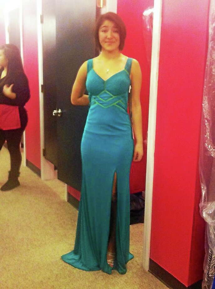 """Maren Sanchez posted a photo to Facebook """"JLHS Prom Dresses 2014"""" a photo of her trying on her prom dress on March 2 with the caption, """"Yay so excited!!"""" Photo: Facebook Photo"""