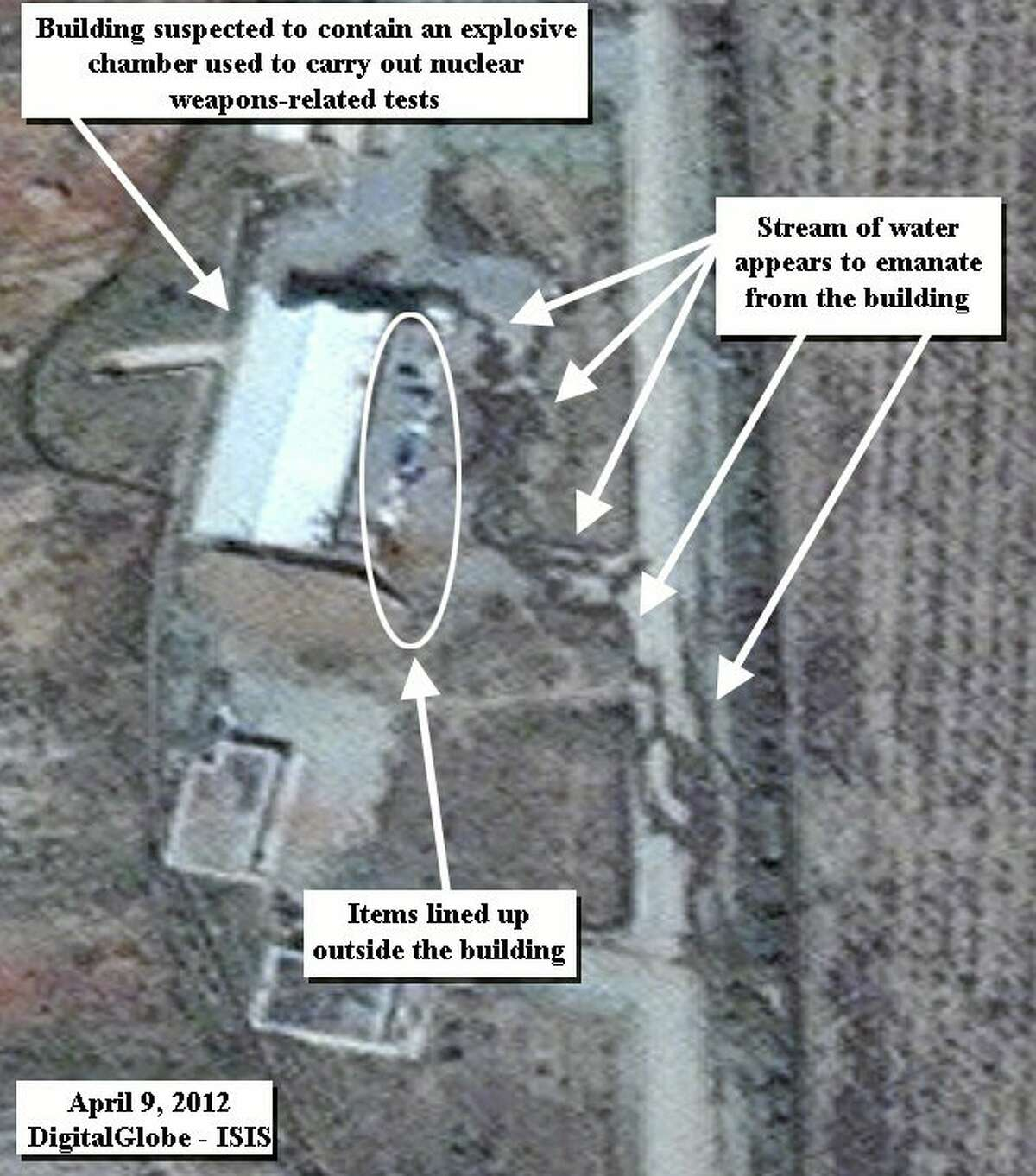 This photo from April 9, 2012, provided by the Institute for Science and International Security, shows activities in a building that is said to contain a chamber for weapons testing in Parchin military complex in Iran. A U.S. institute that tracks Iran's nuclear program said Aug. 22 that recent satellite images reveal significant alterations of a military site, which the United Nations will try to access after suspicions that Tehran may have used it in an attempt to develop nuclear weapons. (AP Photo/ISIS, handout)
