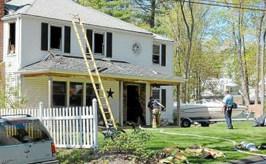 Kate Hartman/Register Citizen - A second-alarm fire damaged a home at 29 Adelaide Terrace in Torrington Monday afternoon.
