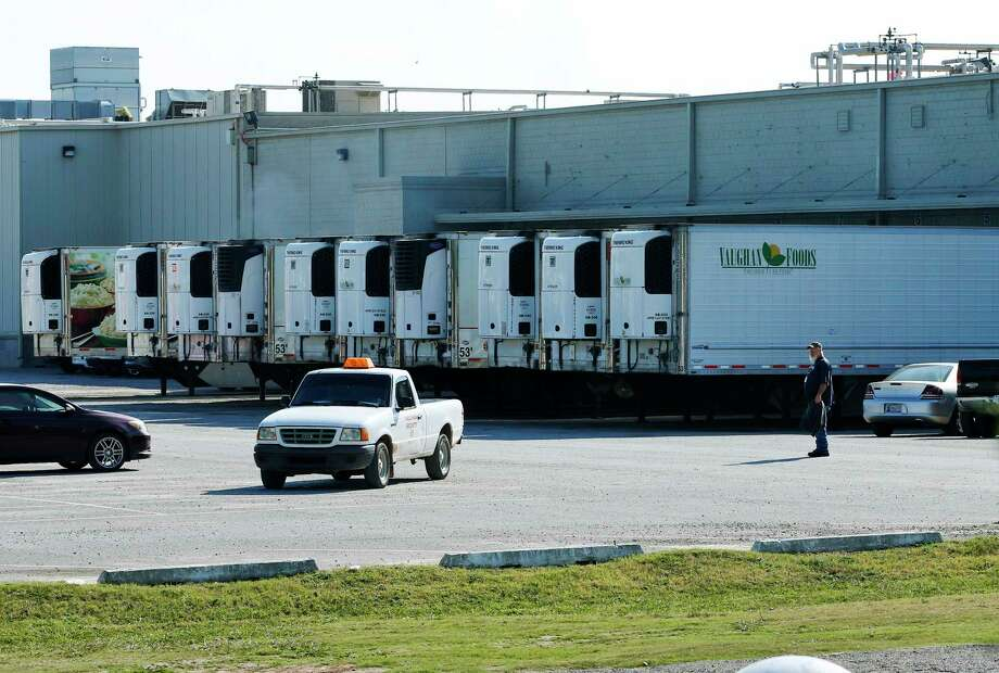 Trucks are parked in a parking lot at Vaughn Foods in Moore, Okla., Friday, Sept. 26, 2014, the site of an incident where a man beheaded a woman with a knife and was attacking another worker when he was shot and wounded by a company official, on Thursday. Photo: (AP Photo/Sue Ogrocki) / AP