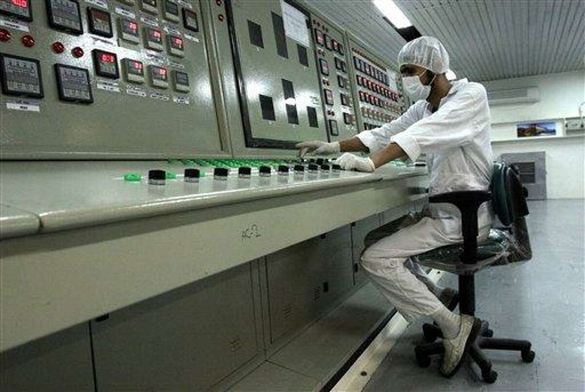 FILE - In this Saturday, Feb. 3, 2007 file photo, an Iranian technician works at the Uranium Conversion Facility just outside the city of Isfahan 255 miles (410 kilometers) south of the capital Tehran, Iran. The sophisticated cyberweapon which targeted an Iranian nuclear plant is older than previously believed, an anti-virus firm said Tuesday Feb 26 2013, peeling back another layer of mystery on a series of attacks attributed by The New York Times to U.S. and Israeli intelligence.(AP Photo/Vahid Salemi, File)