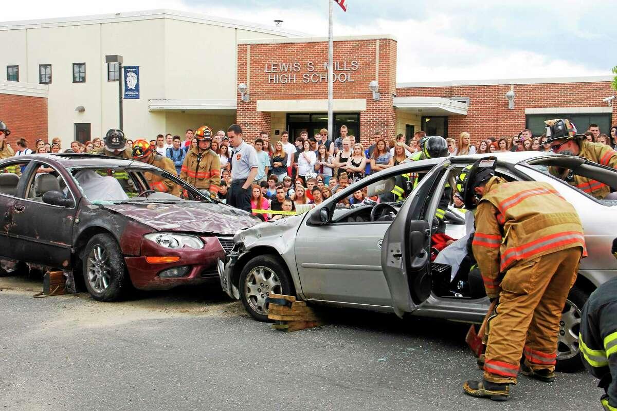 The scene of a mock car accident on Friday, May 30, 2014, at Lewis Mills High School in Burlington. Esteban L. Hernandez Register Citizen