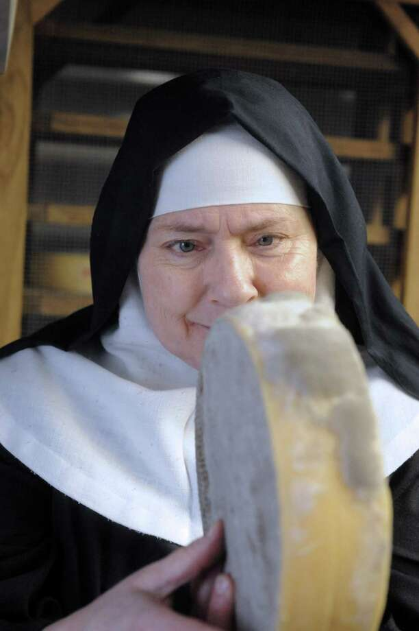 Sister Noella Marcellino checks out a wheel of cheese. Photo by Laurie Gaboardi/The Litchfield County Times