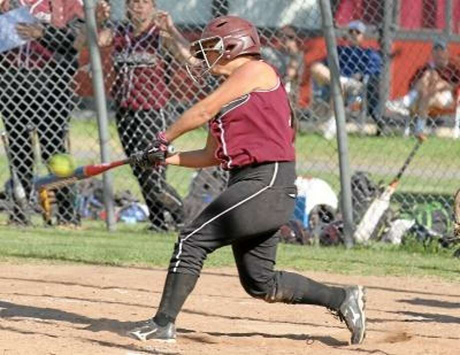 Photo by Marianne Killackey/Special to Register Citizen Baylee Vinisko of the Lady Raiders connects with a double in her team's win over Kennedy Monday afternoon at Torrington High School. / 2013