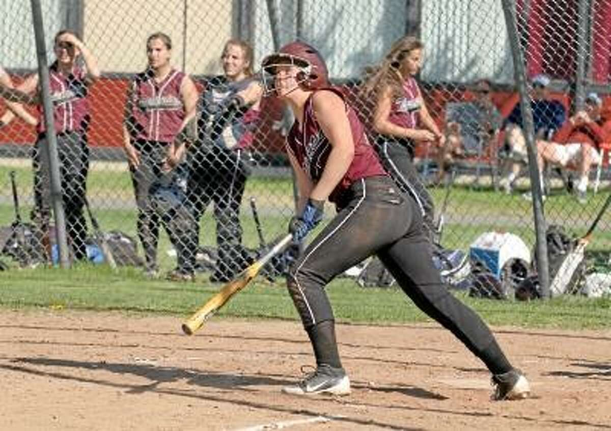 Photo by Marianne Killackey/Special to Register Citizen Torrington's Brittany Anderson watches the ball after hitting a three run homer.