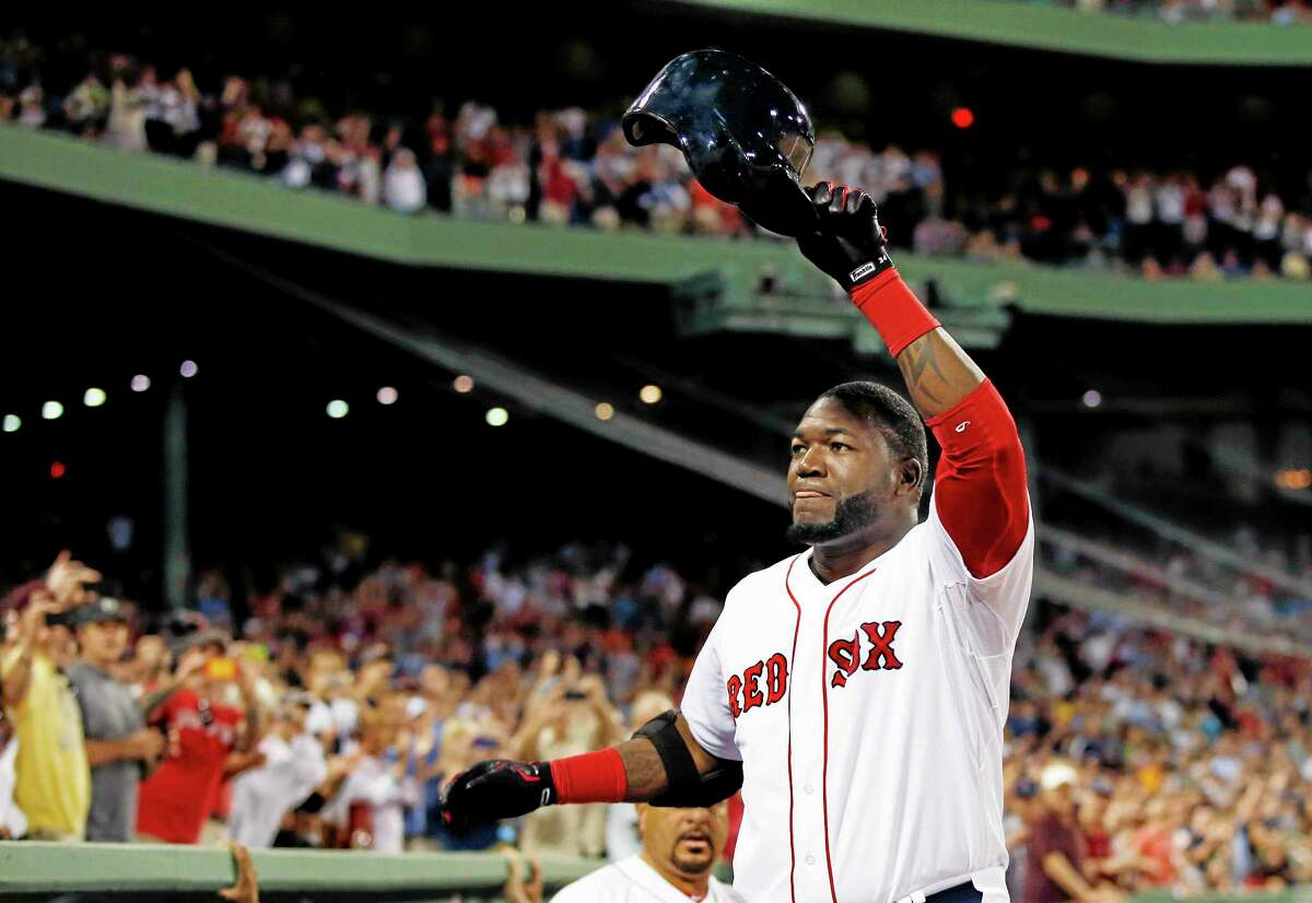 Red Sox designated hitter David Ortiz comes out of the dugout and tips his helmet to the fans after hitting his second home run of the night, his 2,001st career hit, in the seventh inning of Thursday's game against the Detroit Tigers at Fenway Park in Boston on Wednesday.