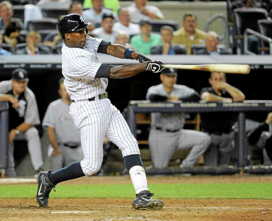 The Yankees' Alfonso Soriano hits a sacrifice fly to score Derek Jeter during the seventh inning of Wednesday's game against the Chicago White Sox. The Yankees won 6-5. Photo: Bill Kostroun — The Associated Press  / FR51951 AP