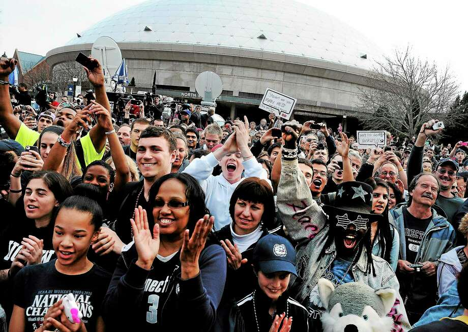 Jessica Hill — The Associated Press Fans cheer outside Gampel Pavilion during a rally honoring the women's basketball team's national championship in April. Photo: AP / FR125654 AP