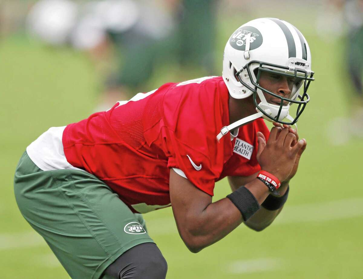 New York Jets quarterback Geno Smith stretches during an organized team activity on Wednesday in Florham Park, New Jersey.
