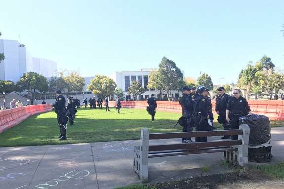 """Police stand guard at Martin Luther King Jr. Civic Center Park in Berkeley ahead of Sunday's """"No to Marxism in America"""" rally."""