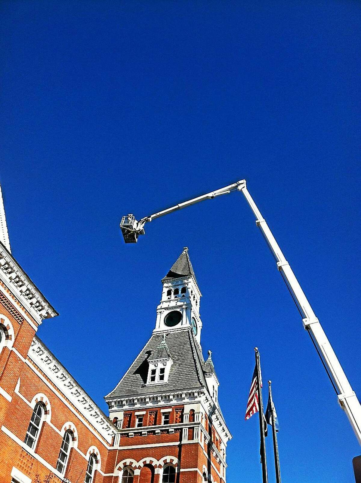 CL&P helps replace lights on top of the Thomaston Opera House.