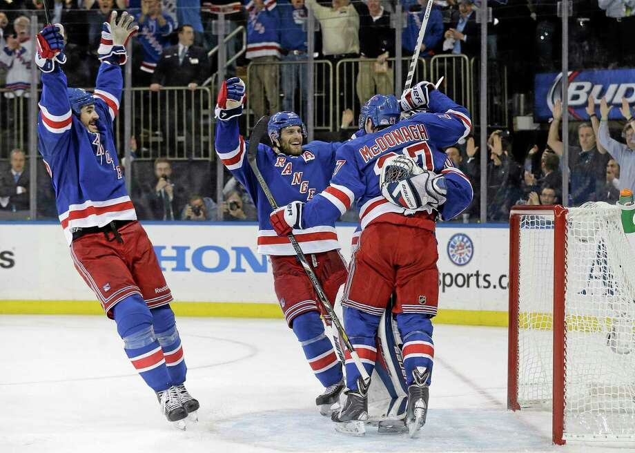 The Rangers celebrate after beating the Montreal Canadiens 1-0 in Game 6 of the Eastern Conference finals on Thursday in New York. The Rangers advance to the Stanley Cup finals. Photo: Julie Jacobson — The Associated Press  / AP