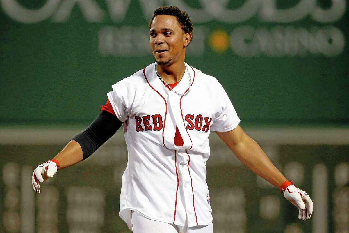 The Red Sox's Xander Bogaerts appears disheveled after being mobbed by teammates after his game-winning hit against the Atlanta Braves on Thursday at Fenway Park in Boston.