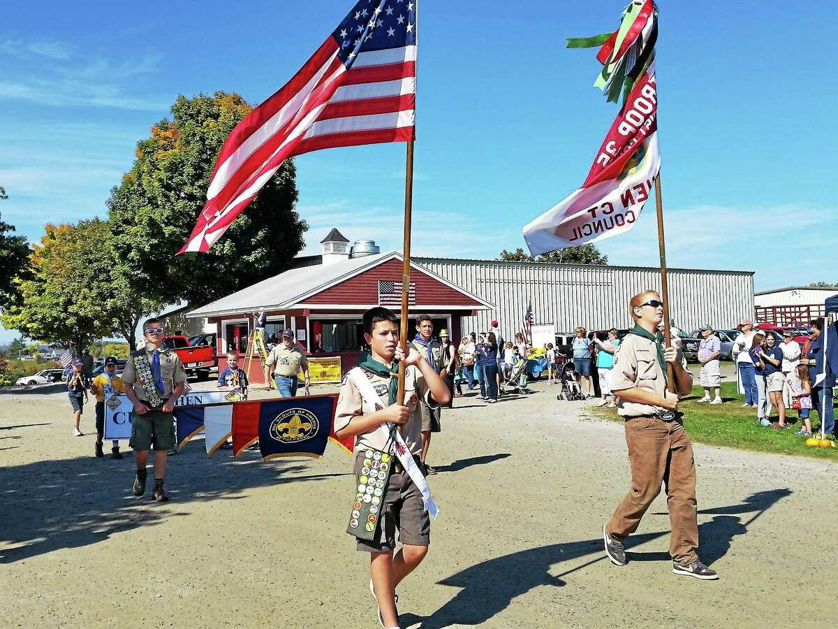 Boy Scouts' Troop 35 of Goshen march in the parade during Goshen's 275th Anniversary at Goshen Fairgrounds on Sunday.