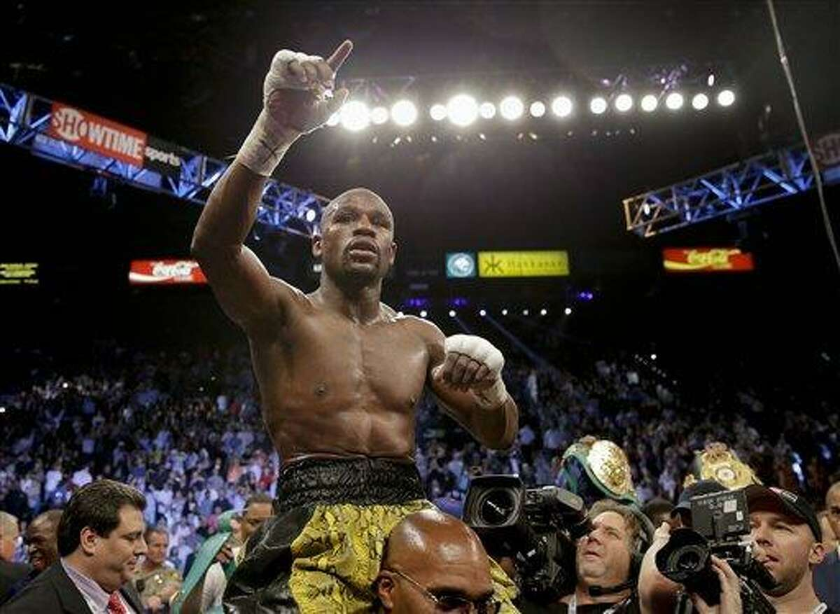 Floyd Mayweather Jr. reacts after defeating Robert Guerrero by unanimous decision in a WBC welterweight title fight, Saturday, May 4, 2013, in Las Vegas. (AP Photo/Isaac Brekken)