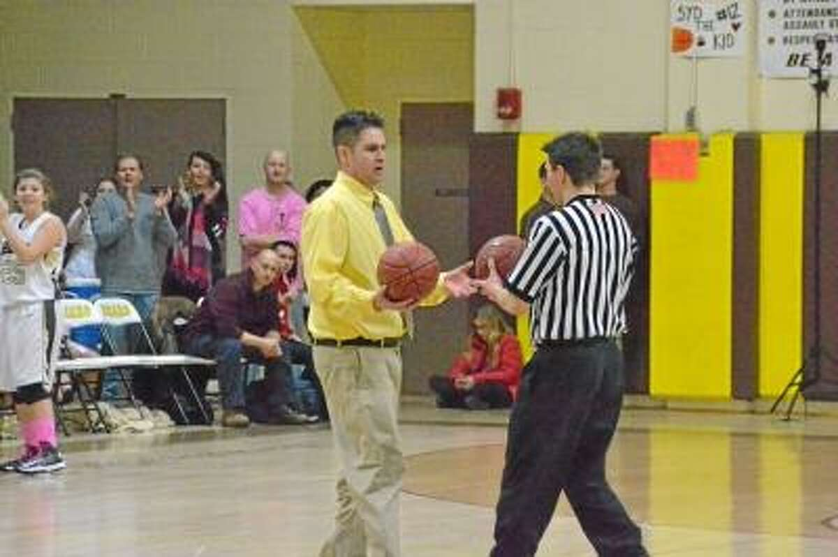 Thomaston head coach Bob McMahon giving the referee a new game ball, so he could give Maggie her 1000th career ball. Pete Paguaga/Register Citizen