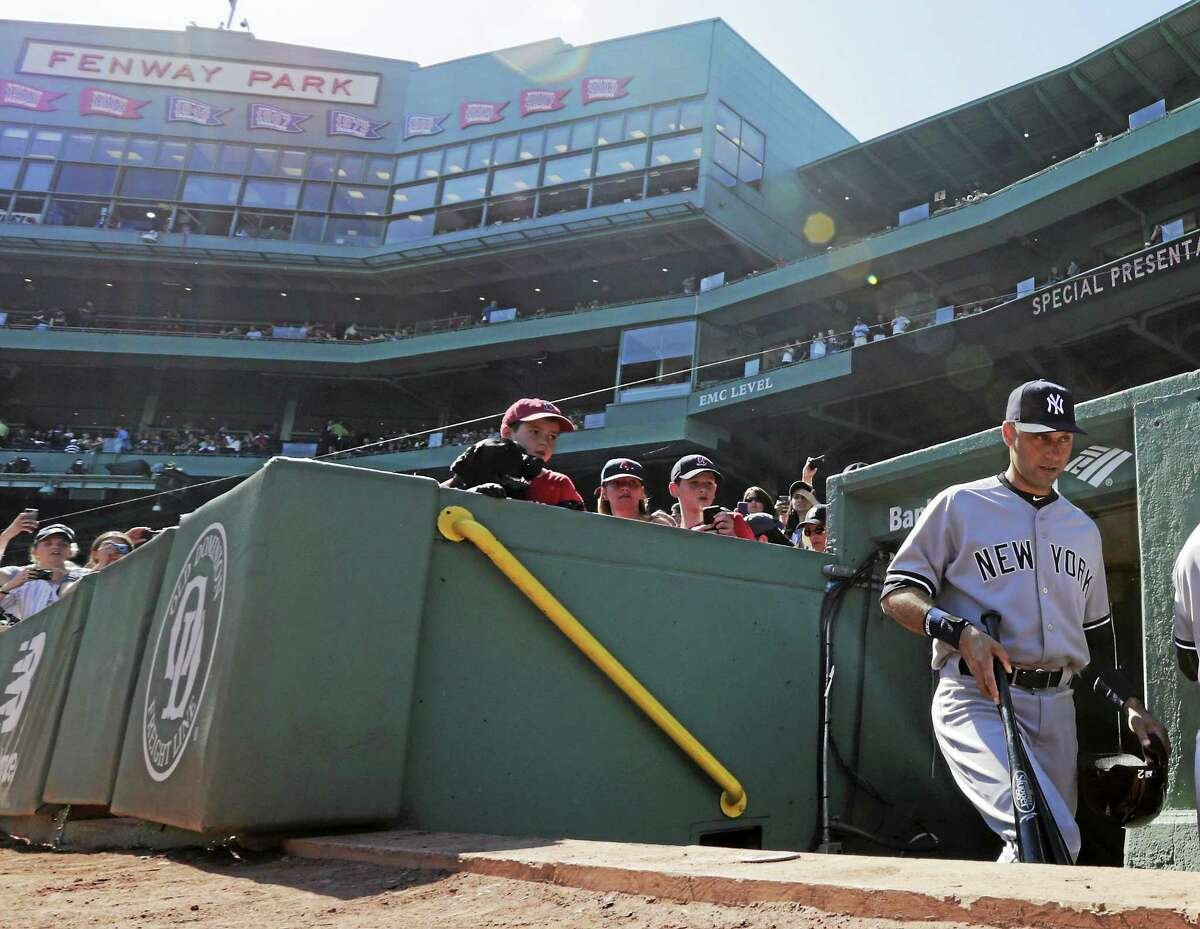 Derek Jeter walks to the dugout before the first inning of Saturday's game against the Red Sox.