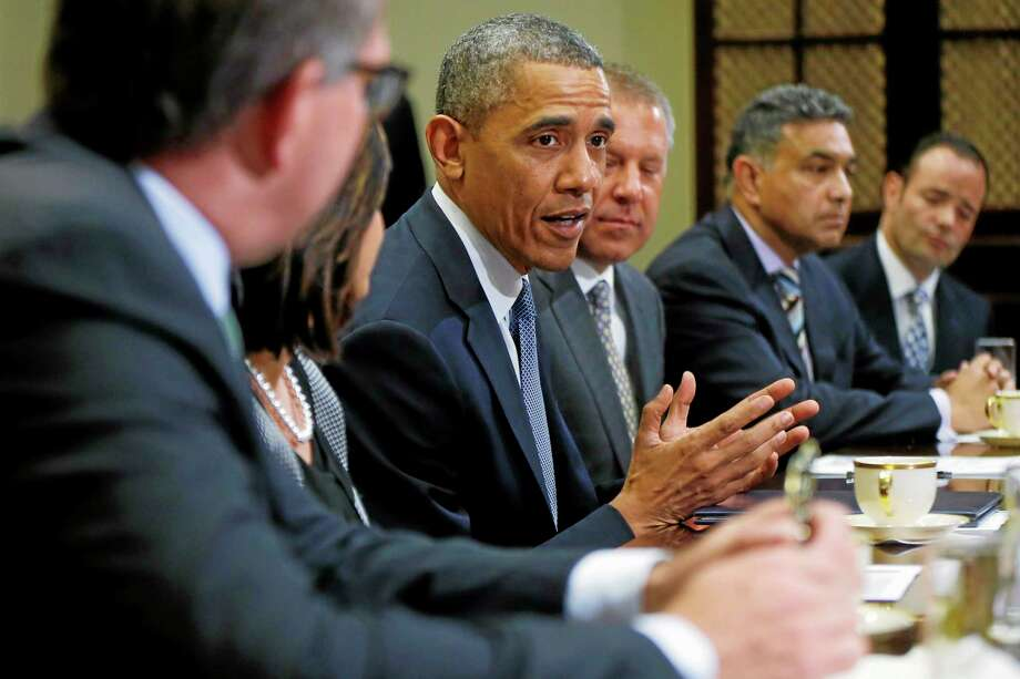 President Barack Obama meets with business leaders about creating and investing in jobs in the U.S. Tuesday, May 20, 2014, in the Roosevelt Room of the White House in Washington. From left are: Carsten Spohr, Chairman and CEO, Deutsche Lufthansa AG; Ravila Gupta, President, Umicore USA; the president; Joe Hinrichs, Executive Vice President and President of the Americas, Ford Motor Company; Sanjay K. Jha, CEO, Globalfoundries; Michael Penner, President, Richelieu. (AP Photo/Charles Dharapak) Photo: AP / AP