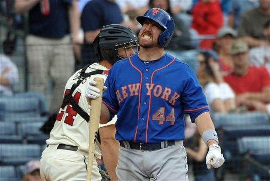 New York Mets' John Buck (44) reacts after he was hit by a pitch during the eighth inning of a baseball game against the Atlanta Braves at Turner Field, Sunday, May 5, 2013, in Atlanta. (AP Photo/David Tulis) Photo: AP / FR170493 AP