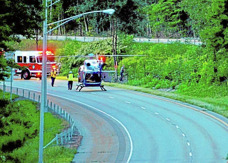 Emergency responders at the scene of a motorcycle crash on Route 8 in Torrington. LifeStar landed on the highway to transport the victim. Photo: Tom Cleary - Register Citizen