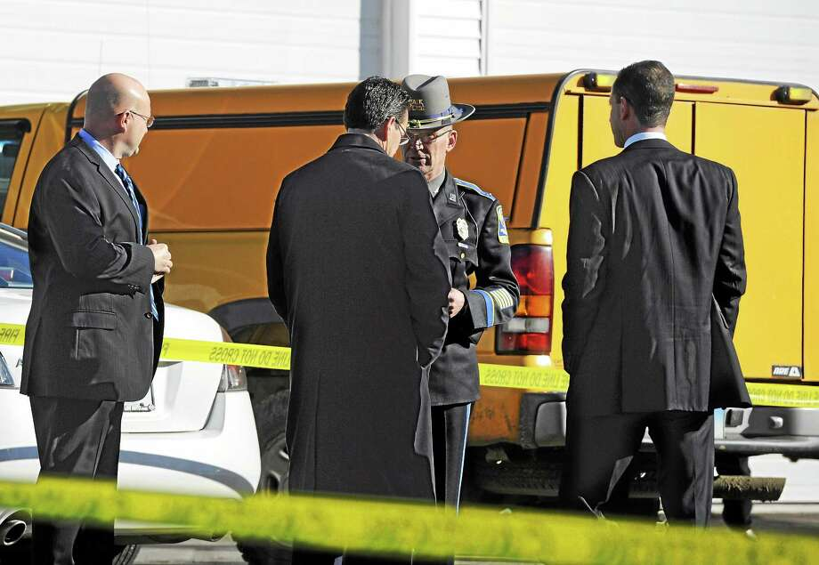 File photo: Connecticut Gov. Dannel P. Malloy, second from left, is briefed by Colonel Danny R. Stebbins, Commander of the Connecticut State Police, center, in Newtown, Conn., Dec. 14, 2012. Photo: (AP Photo/Jessica Hill) / A2012