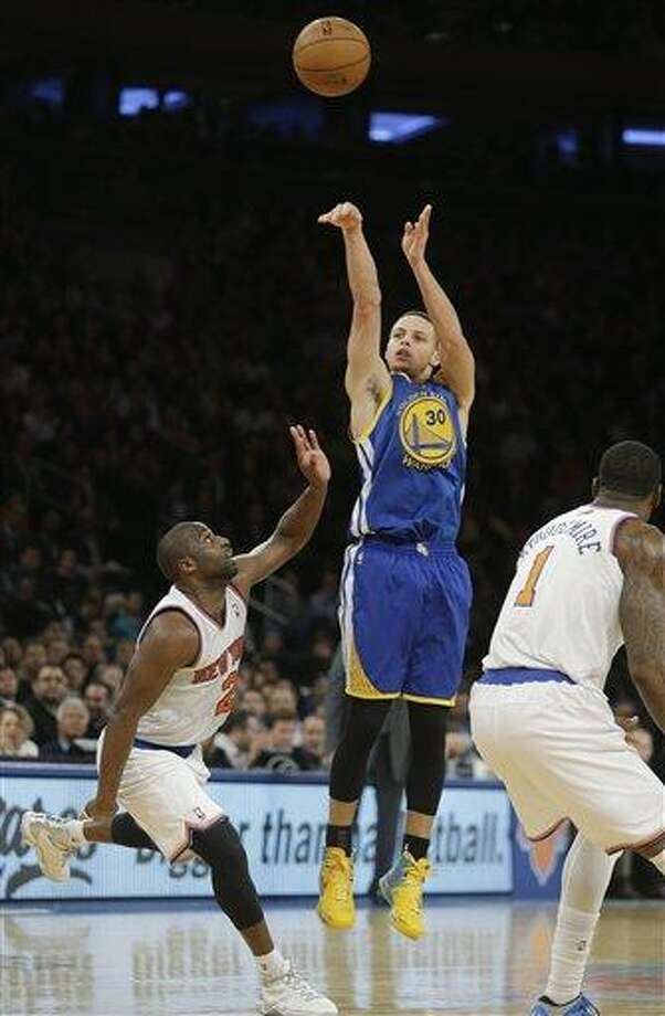 Golden State Warriors' Stephen Curry, center, shoots over New York Knicks' Raymond Felton, left, and Amare Stoudemire, right, during the second half of an NBA basketball game on Wednesday, Feb. 27, 2013, in New York. Curry scored 54 points. The Knicks won the game 109-105. (AP Photo/Frank Franklin II) Photo: ASSOCIATED PRESS / AP2013