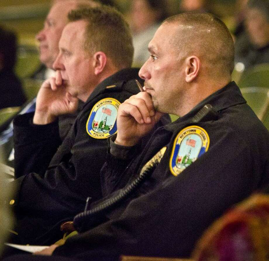 Danbury-Two Newtown Police Officers listen as Jamie Howard Ph.D. (Clinical Pshchologist  and Director Stress and Resilience Program Child Mind Institute) discribes the symptoms of Post Traumatic Stress disorder. Melanie Stengel/Register
