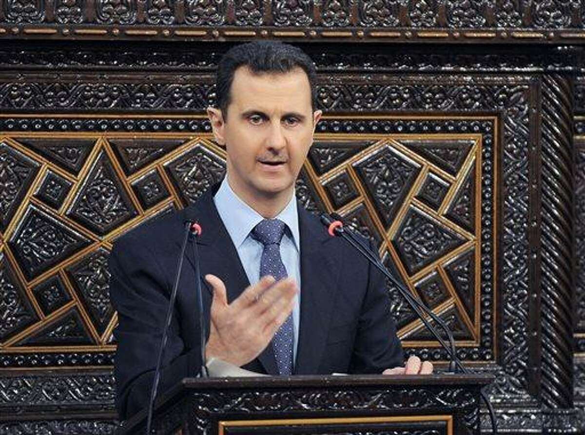 In this 2012 file photo released by the Syrian official news agency SANA, Syrian President Bashar Assad delivers a speech at the parliament in Damascus, Syria. Israel launched an airstrike into Syria, apparently targeting a suspected weapons site, U.S. officials said Friday night, May 3, 2013. (AP Photo/SANA, File)