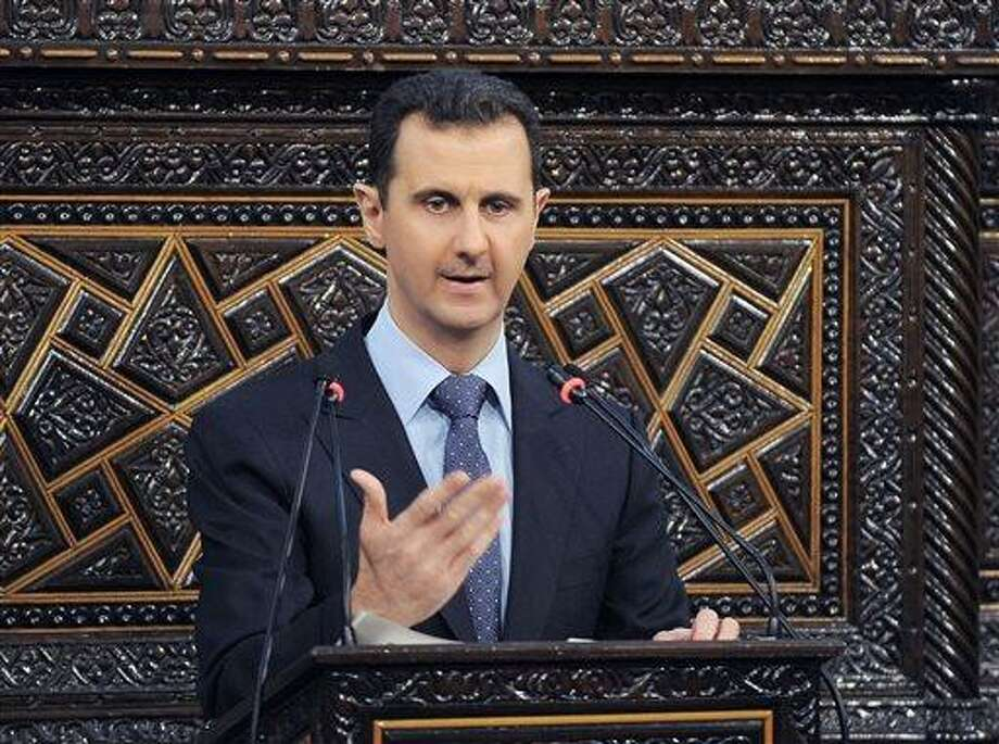 In this 2012 file photo released by the Syrian official news agency SANA, Syrian President Bashar Assad delivers a speech at the parliament in Damascus, Syria. Israel launched an airstrike into Syria, apparently targeting a suspected weapons site, U.S. officials said Friday night, May 3, 2013. (AP Photo/SANA, File) Photo: AP / SANA