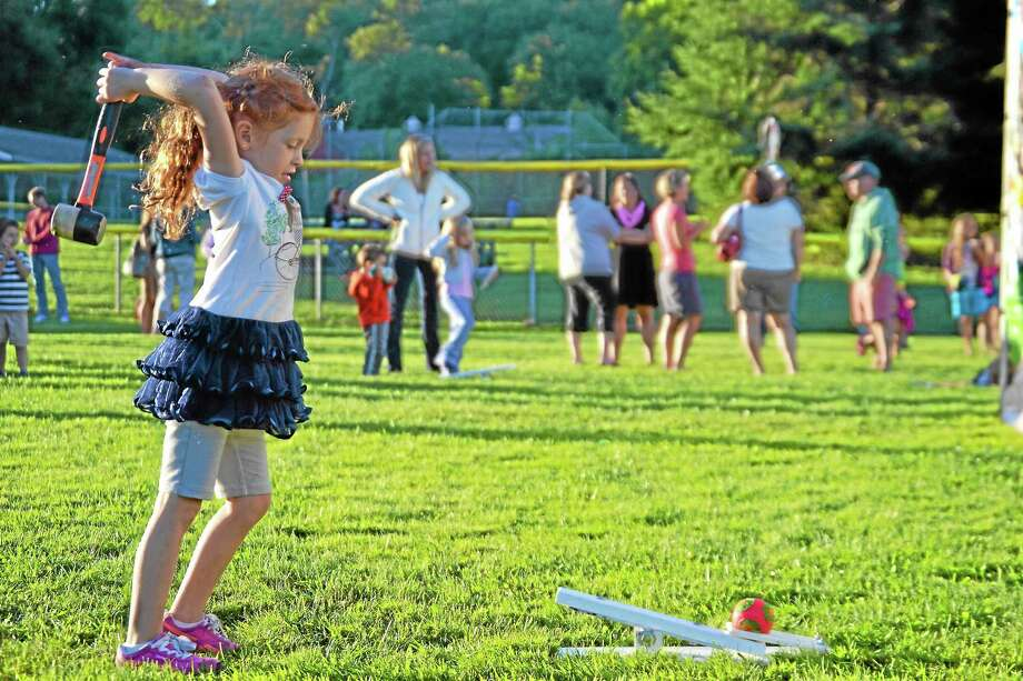 Alyson Schmitz tries to hit the target in one of the frame games Thursday night. Photo: Photos By Ryan Flynn - Register Citizen
