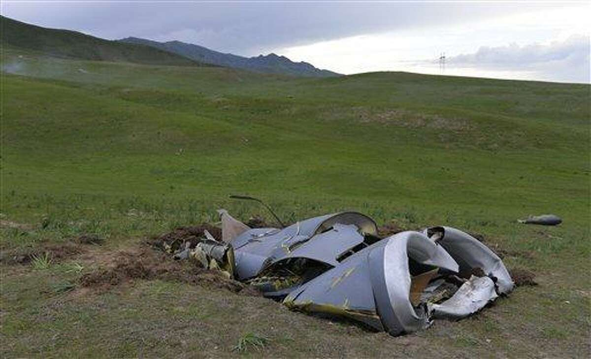 Wreckage from a U.S. Air Force KC-135 tanker aircraft wreckage is strewn across a field near the village of Chaldovar, about 100 miles (160 kms) west of the Kyrgyz capital Bishkek, Friday, May 3, 2013. The emergencies ministry in Kyrgyzstan says a US military plane has crashed in the country. Kyrgyzstan hosts a US base that is used for troops transiting into and out of Afghanistan and for C-135 tanker planes that refuel warplanes in flight. (AP Photo/Vladimir Voronin)