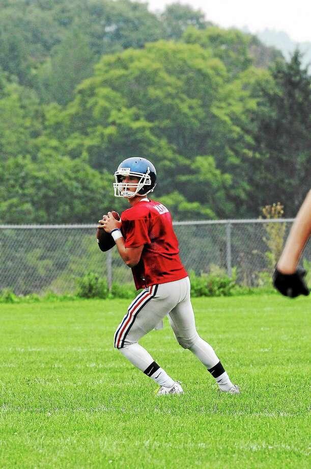 Laurie Gaboardi—Register Citizen St. Paul quarterback Logan Marchi participates in a recent scrimmage against Gilbert. Photo: Journal Register Co.